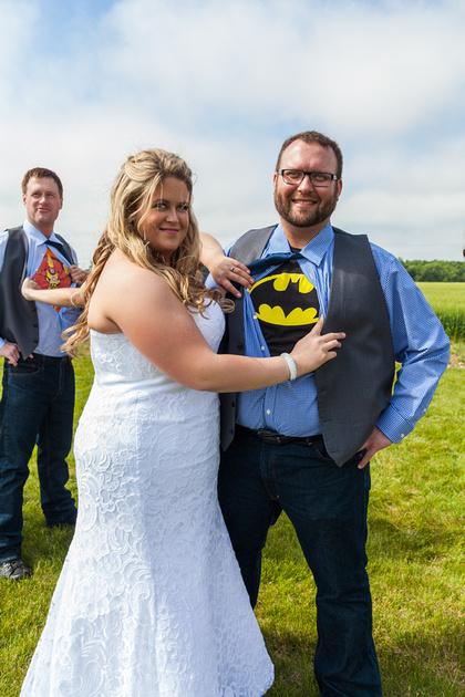 The bride with her superhero groom