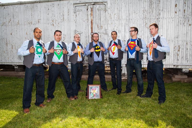 groomsmen showing their superhero T-Shirts
