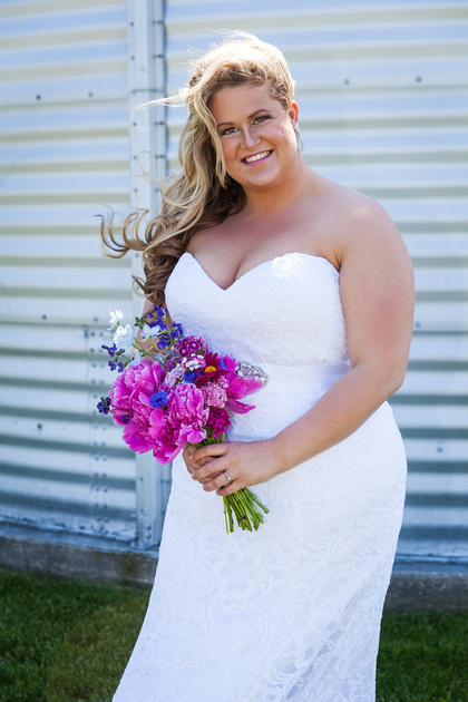 bride in her dress with hair blowing in the wind