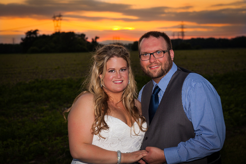 sunset picture with bride and groom